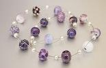 Halsschmuck mit 16 violetten Murano-Glasperlen und 925 Silberverschluss (ca. 55 cm). Verkauft an Natalie in Dornach-Basel